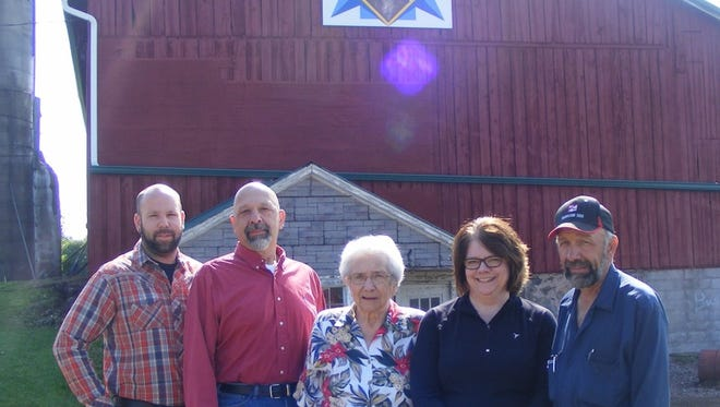 Pictured are the Buck family with the barn quilt. Family members pictured are Matt Buck, from left, Lloyd Buck Jr., Ruth Buck, Lynn Seidler (Buck), and David Buck.