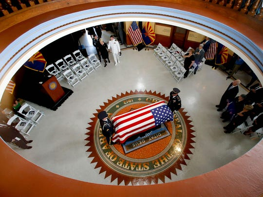 The Arizona National Guard carries the casket into the museum rotunda during a memorial service for Sen. John McCain, at the Arizona Capitol on August 29, 2018, in Phoenix.