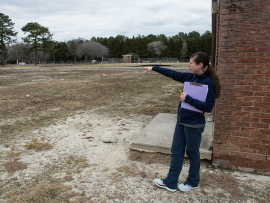 Amy Sorg, wellness director with the Richard A. Henson YMCA, shows the area where the new swimming pools are to be constructed.