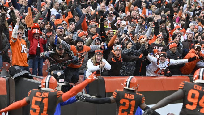 Browns cornerback Denzel Ward (21) celebrates his touchdown with fans during a game against the Cincinnati Bengals in December.