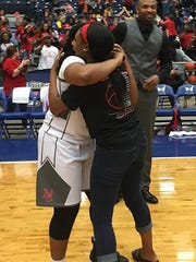 Two North Caddo players share a hug.