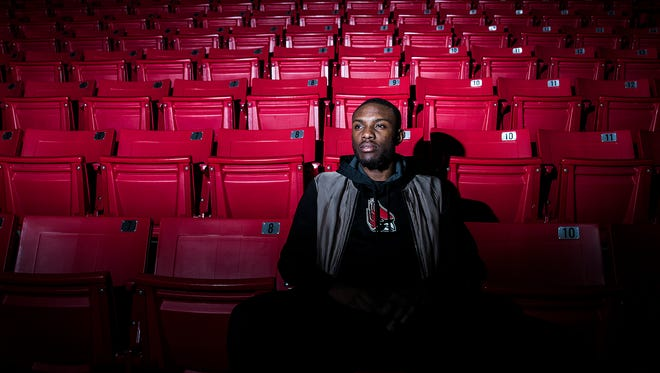 Scholarship money helps Francis Kiapway, seen here at Worthen Arena, support his mom.