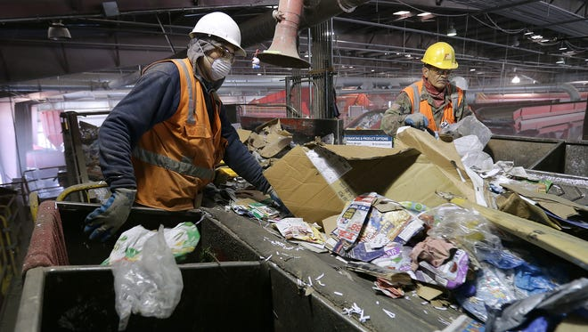 Sorters remove nonrecyclable materials from the blue bin contents Thursday at the Friedman Recycling Plant in Northeast El Paso.