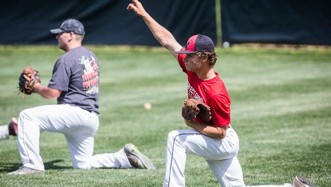 Wapahani pitcher Chandler Wise practices with teammates at Wapahani High School Tuesday, June 7, 2017.