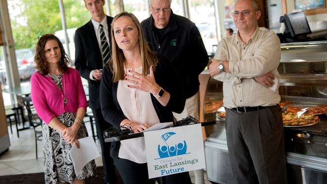 Michigan State University Council of Graduate Students President Ashley Fuente, center, speaks in opposition of an East Lansing business tax during a press conference organized by Citizens for East Lansing's Future on Monday, Sept. 11, 2017, at Bell's Greek Pizza in East Lansing. In the background, from left, are Prime Housing Group President Nancy Marr, Associated Students of MSU President Lorenzo Santavicca, East Lansing resident Don Power and Bell's Greek Pizza Owner Habib Jarwan.