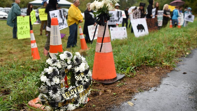 A memorial wreath for all killed black bears rests on the side of Fredon-Springdale Rd. in front of protestors against New Jersey's black bear hunt. The opening day of the archery portion of the black bear hunt was Monday, October 9, 2017
