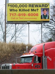 A billboard asking for information in the death of