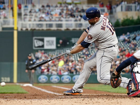 Houston Astros' Brian McCann hits into a double play scoring Jose Altuve from third base in the fourth inning of a baseball game against the Minnesota Twins Tuesday, May 30, 2017 in Minneapolis. (AP Photo/Jim Mone)