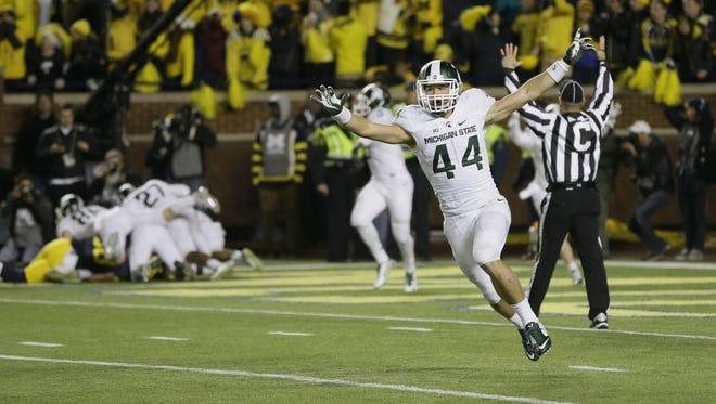 Michigan State safety Grayson Miller celebrates after beating Michigan last season.