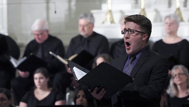 Joel Vega sings a solo during a holiday performance at St. Peter's Church in 2015.