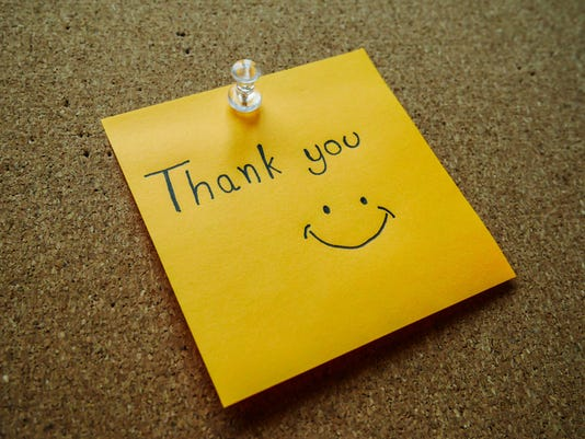 """Thank you"" on post it note"
