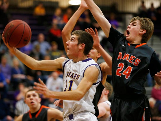 Indianola's Kam Hartung (11) gets the layup ahead of