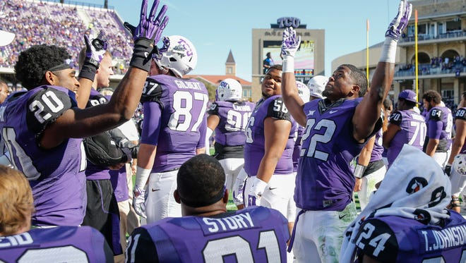 TCU Horned Frogs running back Aaron Green (22) celebrates with  wide receiver Deante' Gray (20) after scoring a touchdown during the second half against the Iowa State Cyclones at Amon G. Carter Stadium.