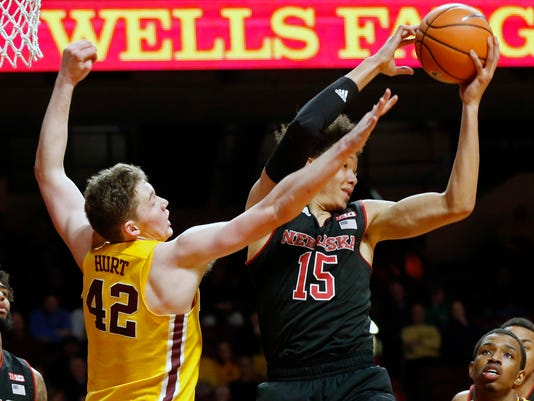 Nebraska's Isaiah Roby, right, pulls in a rebound in front of Minnesota's Michael Hurt in the second half of an NCAA college basketball game Tuesday, Feb. 6, 2018, in Minneapolis. Nebraska won 91-85. Roby led Nebraska with 21 points. (AP Photo/Jim Mone)