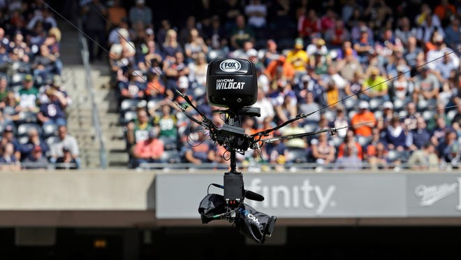 FILE - In this Sept. 13, 2015, file photo, Fox Sports's SkyCam Wildcat camera hangs over the field during the second half an NFL football game between the Chicago Bears and the Green Bay Packers in Chicago. NBC will unveil a second SkyCam for Sunday night's Super Bowl rematch between the Patriots and Falcons. The original SkyCam, shown, is used for games flies anywhere from 12 feet to 40 feet above the playing field. The high SkyCam goes from 40 to 80 feet and probably will wind up mostly right in between that height.  (AP Photo/Nam Y. Huh, File)