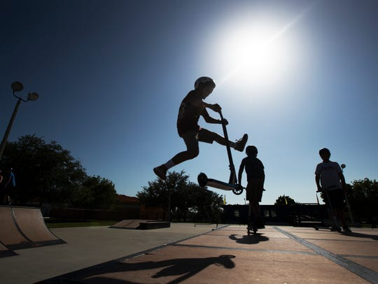 Anthony Rodriguez, 13, of Cape Coral, rides his scooter