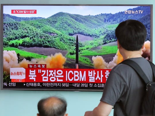 "FILE - In this Tuesday, July 4, 2017, file photo, people watch a local TV news showing what was said to be the launch of a Hwasong-14 intercontinental ballistic missile, ICBM, aired by North Korea's KRT, at Seoul Train Station in Seoul, South Korea. Despite U.S. President Donald Trump's hopes for China's help in dealing with North Korea and his recent tough talk on the matter, the two sides seem to be growing further apart as their approaches and concerns diverge. China shows no sign of caving in to U.S. pressure to tighten the screws on North Korea, while the North's recent missile tests have done little to rattle Beijing. China's bottom line continues to hold: no to any measures that might topple Kim Jong Un's hard-line communist regime. The part of letters at bottom read: ""North Korea, Kim Jong Un ICBM Launch."" (AP Photo/Lee Jin-man)"