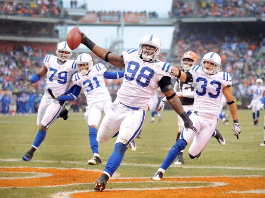 Indianapolis Colts Robert Mathis (#98) scores the game winning touchdown in the fourth of their game Sunday, November 30, 2008, afternoon at Cleveland Browns Stadium in Cleveland OH.