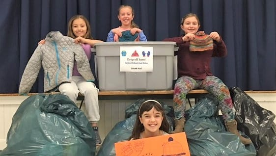 Central School organized a two-week coat drive to collect lightly used coats, hats, gloves and other winter apparel for those in need. Pictured are fourth-graders Ekaterini Papasouliotis (front) and (back from left) Olivia Martignetti, Cecelia Miller and Ashley Parker.