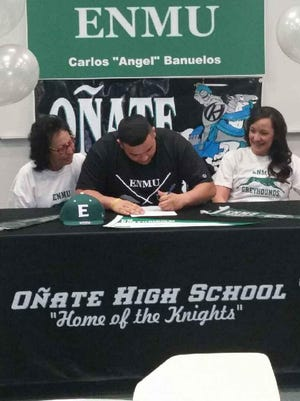 Oñate's Carlos Angel Bañuelos signed a scholarship to play football at Eastern New Mexico University.