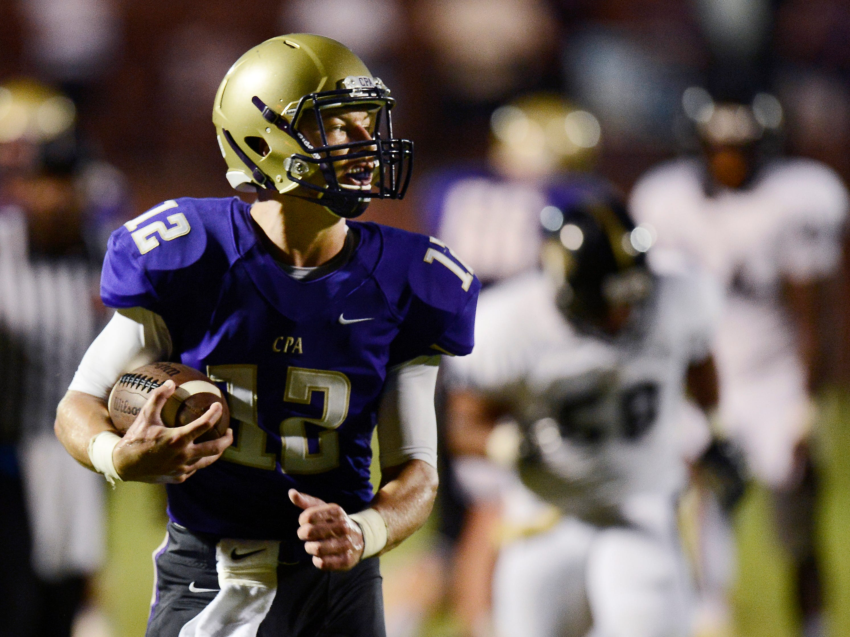 CPA quarterback Jay Hockaday (12) runs for a touchdown against Giles County earlier in the season. The Lions are unbeaten heading into Friday's matchup against Marshall County.