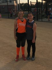 Georgia Bulldogs player Makayla Petroski (right) and Quinn Rosario, a pitcher for the Marlton Chiefs, share a moment of friendship and good sportsmanship. Quinn gave the game ball to Makayla to celebrate her courage.