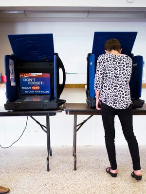 Brenda Rainey votes Tuesday at McCants Middle School in the Republican runoff for South Carolina Senate District 3 seat.