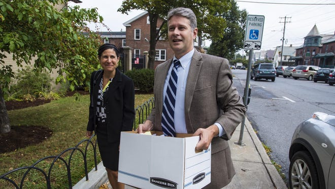Attorney Christopher Curtis enters U.S. District Court in Burlington on Sept. 8 to represent plaintiffs in a lawsuit over cuts to cash assistance for poor Vermont families.