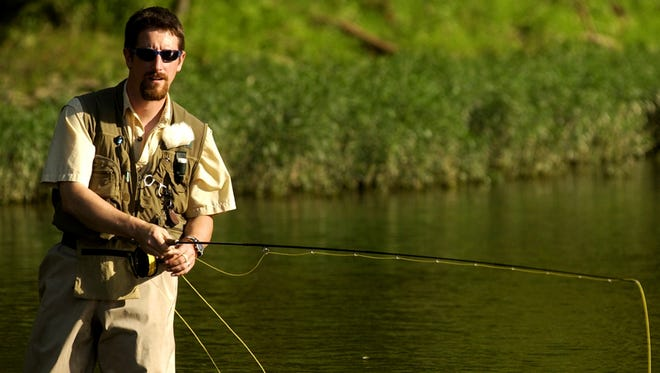 A fisherman follows his line while fly fishing at the Brookville (Ind.) Lake Tailwater Area.