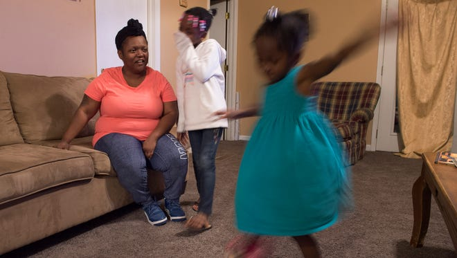 Zynovia Patterson, 4, and her sister Kalanni, 7, dance for their mother, Kennetha Patterson, at their home Tuesday, Feb. 21, 2017, in Chapmansboro, Tenn.