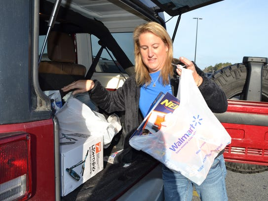 Robin Grant of Salisbury loads up her car after shopping