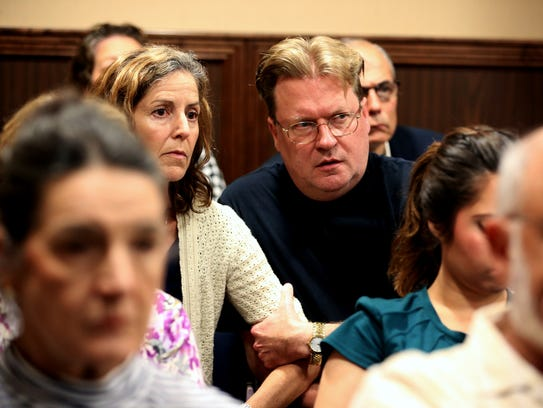 Vivienne Heines (left) and Timothy Heines react as