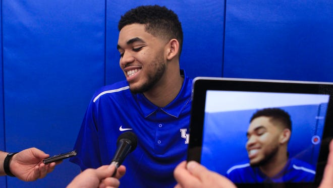 Kentucky's Karl-Anthony Towns talks to the media after declaring for the NBA draft Thursday afternoon from the Joe Kraft Center on the University of Kentucky campus Willie Cauley-Stein, Andrew Harrison, Trey Lyles, Dakari Johnson, Devin Booker and Aaron Harrison are entering the NBA draft.