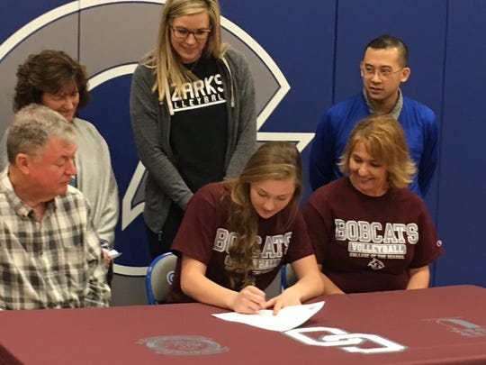Galena High School standout Megan Caulfield signs a letter of intent to play for the College of the Ozarks Lady Bobcats volleyball team this fall, formally committing to the team on Tuesday, Feb. 27, 2018 at Galena High. Also present is Megan's mother, Donna (front, right), her father, Steve (front, left), and (back from left) Galena head volleyball coach Becky Justis, College of the Ozarks coach Stacy Muckenthaler and Galena High School assistant volleyball coach Ryan Lacson.