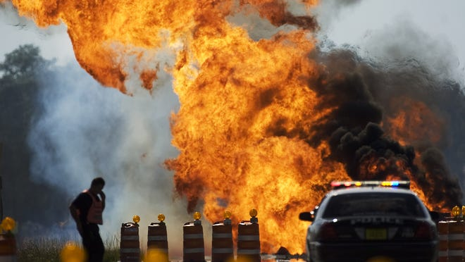 A gas main fire burns out of control in 2010. Two construction workers were injured, one seriously.