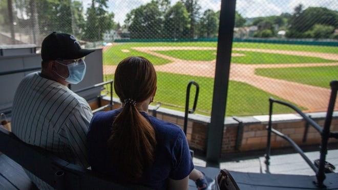 Philip and Julianna Lindenberger, of Canfield, Ohio, ate lunch at Doubleday Field in Cooperstown but had no baseball to watch during the meal. The coronavirus pandemic has taken a drastic toll on the tourism industry in Cooperstown, home of the Baseball Hall of Fame and Museum.