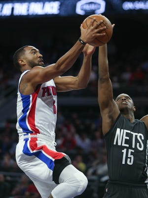 Darrun Hilliard drives against Nets guard Isaiah Whitehead in the third quarter of the Pistons' 90-89 win Thursday, March 30, 2017 at the Palace.