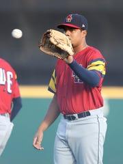 Mud Hens third baseman Jeimer Candelario warms up before