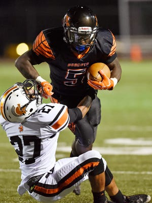 Northeastern's Frank Brown carries the ball against York Suburban's Nate Banks in the second half of a YAIAA football game Friday, Sept. 28, 2017, at Northeastern. Northeastern defeated York Suburban 35-0 in its first home game of the 2017 season.