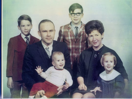 A photo of the Carr family, taken in 1968 in Dayton, Ohio. Left to right: Frank Carr (red jacket); Dick Carr; Richard Carr (plaid jacket and glasses); Mary Carr. In front is my youngest brother, Daniel Carr, and me, Cynthia Carr.