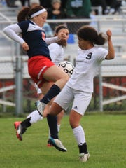 Plymouth senior Hope Sheffield (No. 9) battles for