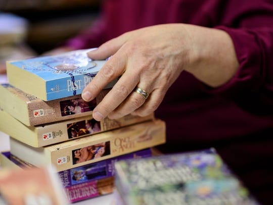 """""""Book Nook"""" owner Wynne Beck tallies up the total cost"""