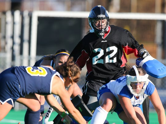 Blue Hens goalkeeper Emmeline Oltmans (22) gets help from a teammate to thwart a goal-scoring chance.