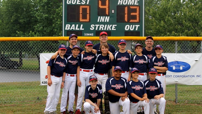 The North Asheville 11/12U baseball team and coaches.