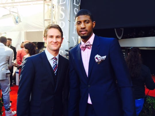 Indy 500 champ Ryan Hunter-Reay poses with Indiana Pacers star Paul George at Wednesday night's ESPY Awards.