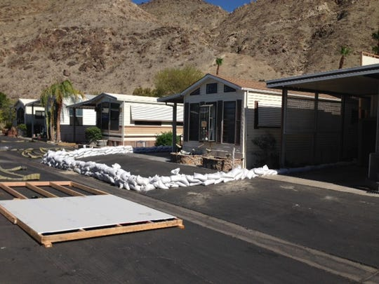 Cathedral City police prepare to bun in place a home with hazardous material. Seen in this photo are the barriers and efforts to protect the surrounding homes.