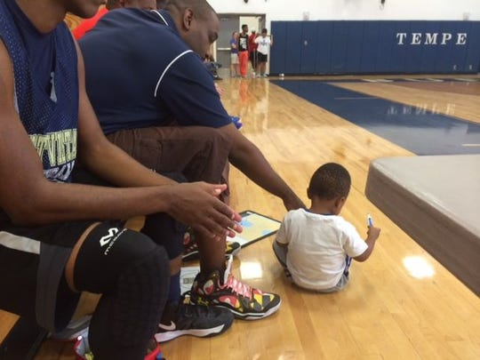Desert Vista basketball coach Tony Darden's son draws up plays during consolation championship game at  Prime Time.
