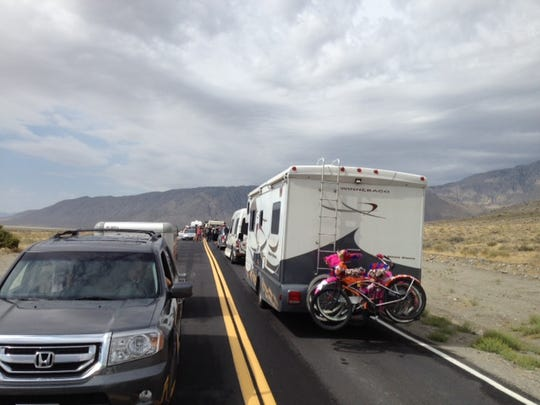 Vehicles sit on the road leading into Burning Man on Monday, Aug. 25 after rain forced officials to close the gates to the festival.