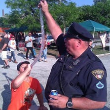 """The photo appears to show a Cleveland Police officer holding a """"beer bong."""""""