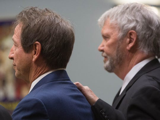 Leo Molina, left, and his attorney, Gary Mitchell,